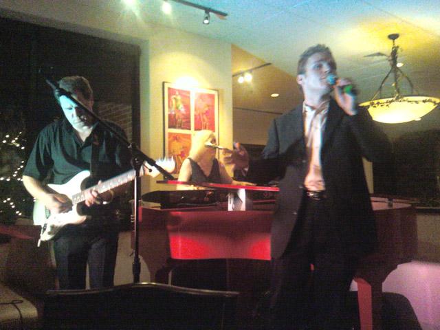 Matt singing at The Moon River Grill